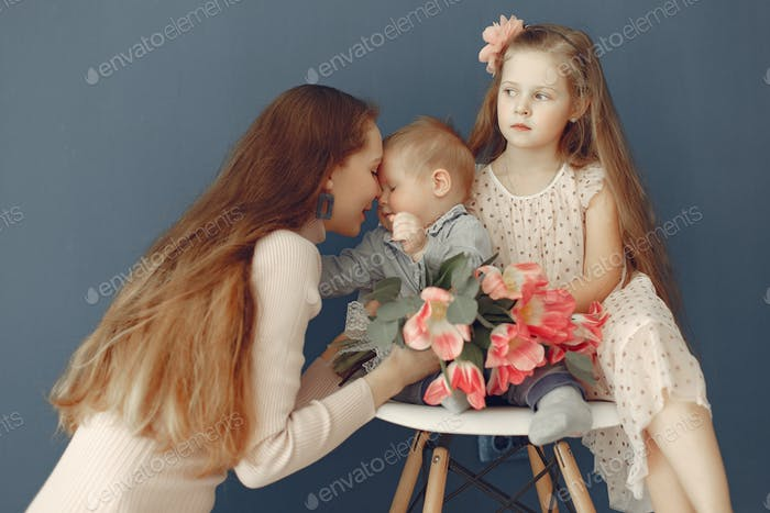 Children gave flowers to mom for mother's day