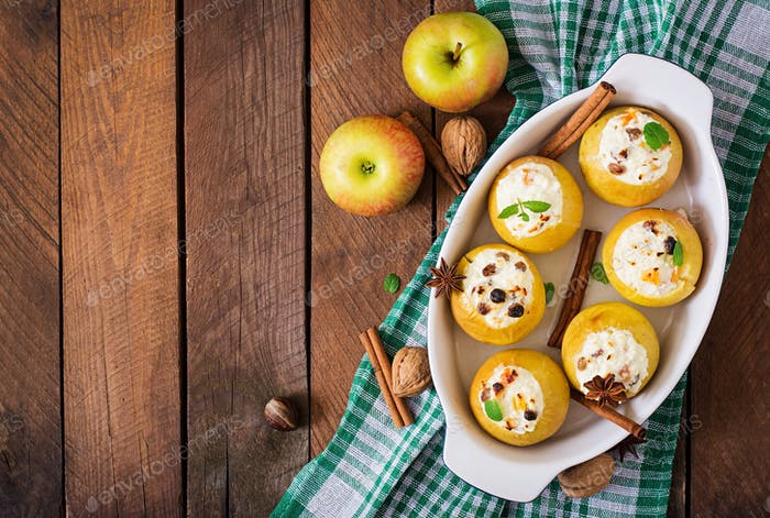 Appetizing baked apples with cottage cheese and raisins. Top view