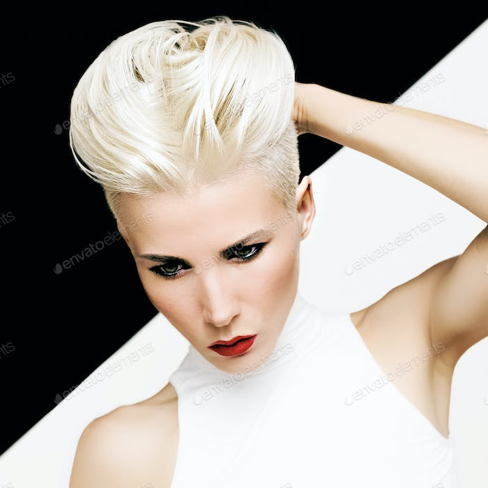 Sensual portrait blonde girl with fashionable hairstyle