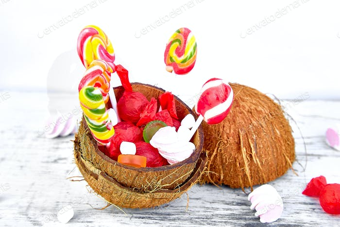 Many different candies in coconut