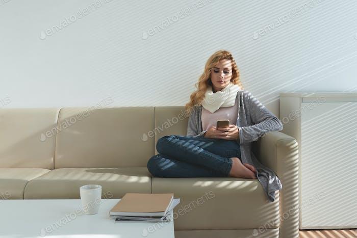Pretty woman resting on sofa