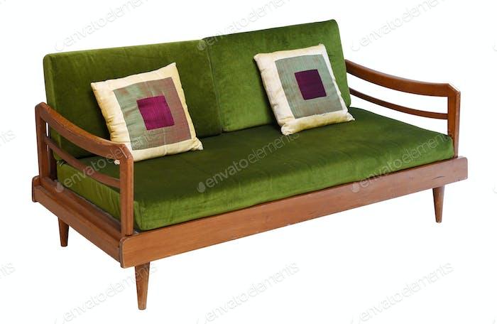 Green velvet sofa on wooden base