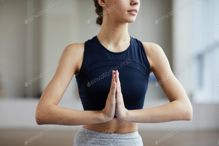 Woman joining hands in Namaste gesture