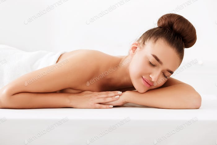 Spa and wellness. Woman relaxing with closed eyes