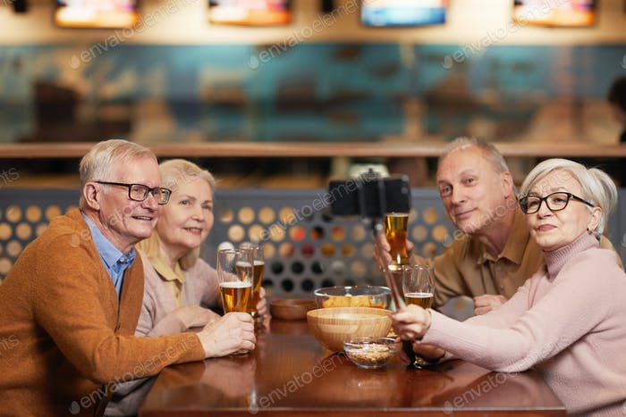 Senior Friends Taking Selfie in Bar