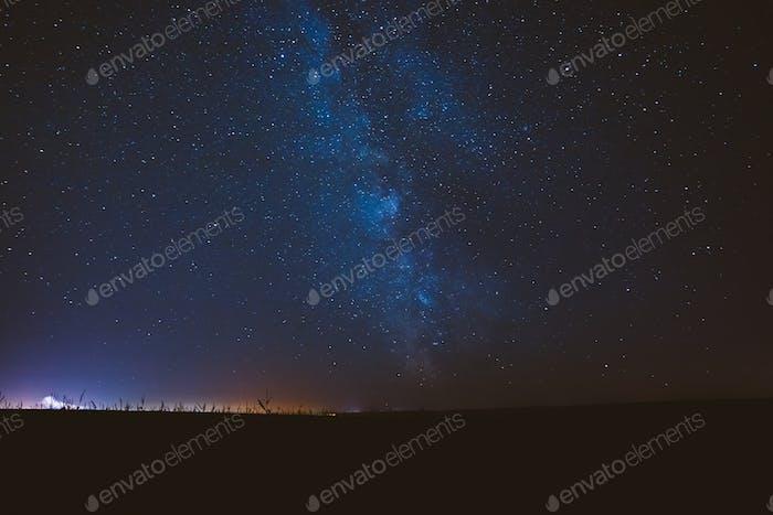 Dark Night Starry Sky Background. Blue Starry Sky Above Field An