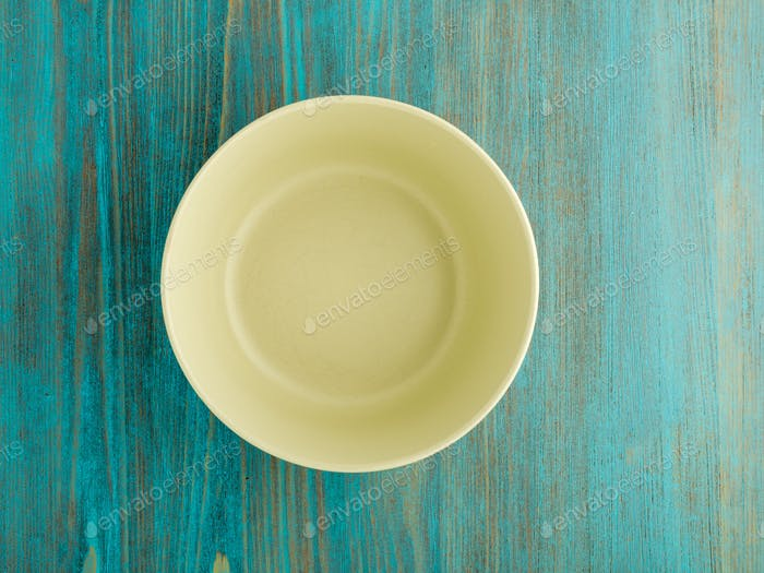 empty ceramic bowl for soup on the old wood turquoise table