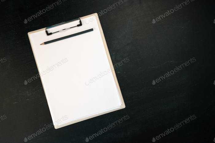 Notes clipboard with pencil and blank sheets of paper