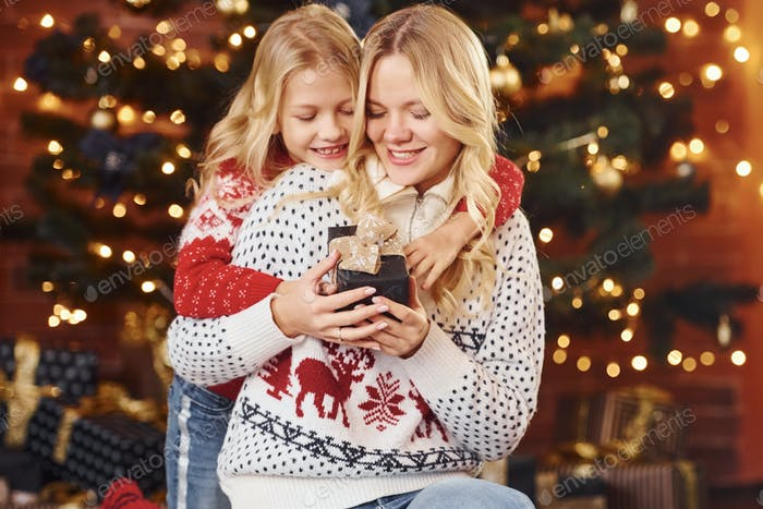 Mother and daughter with gifts celebrating christmas holidays together