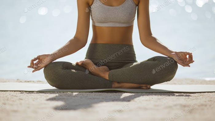 Woman Close-up in Yoga Meditation Pose on Nature