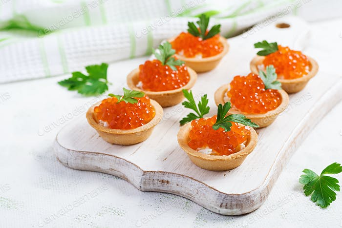 Tartlets with salmon red caviar and feta cheese. Sandwich for lunch. Delicious food.