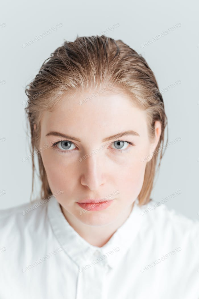 Woman with fresh skin looking at camera