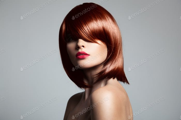 Beautiful Red Hair Model With Perfect Glossy Hair.