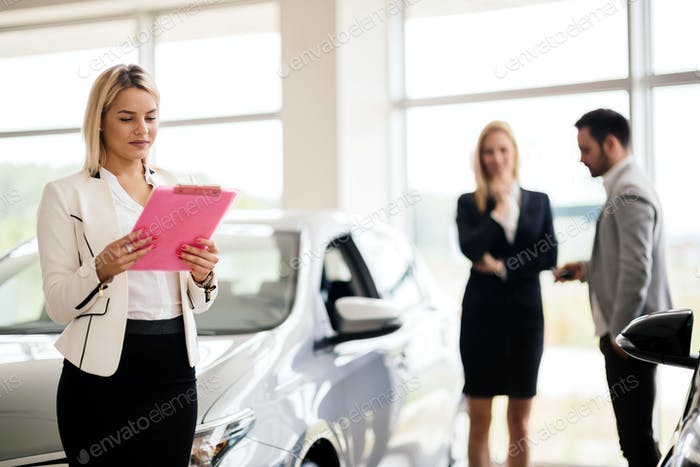 Professional saleswoman at dealership