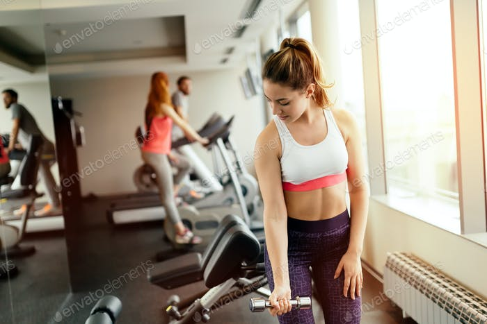 Beautiful woman training in gym