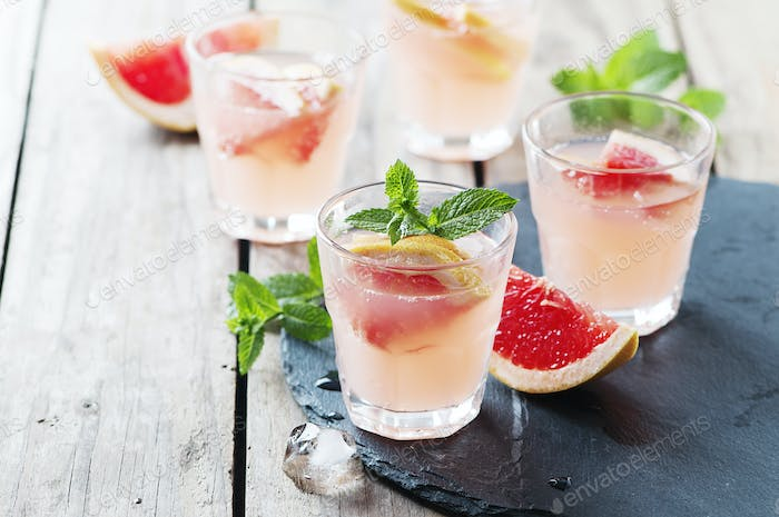 Pink cocktail with ice and mint