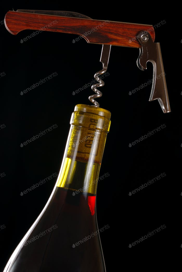 Opening a wine bottle