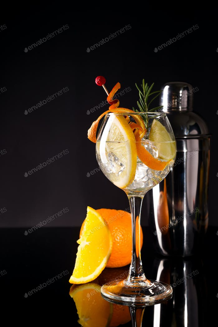 Closeup glass of greyhound cocktail decorated with orange fruit at bright bar counter background