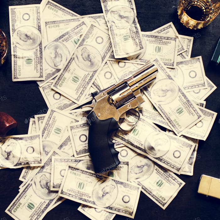 Illegal money and gun on the table