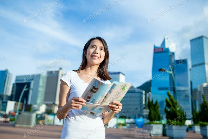 Woman using city guide in Hong Kong