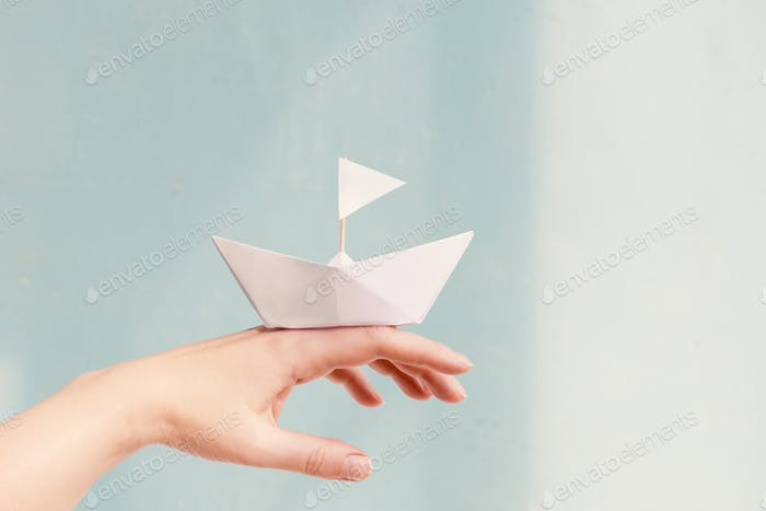 Paper Boat on the Female Hand