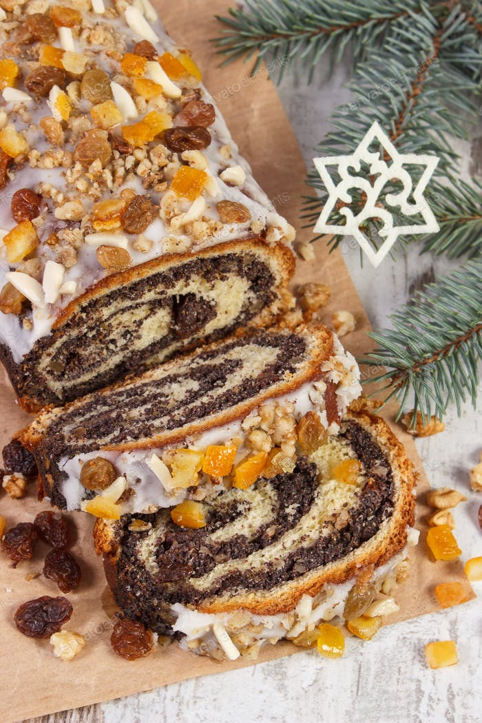 Homemade poppy seeds cake and spruce branches, dessert for Christmas