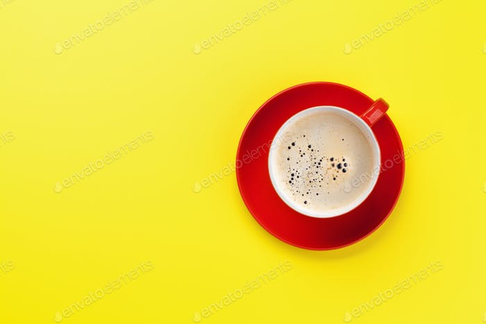 Red coffee cup over yellow background