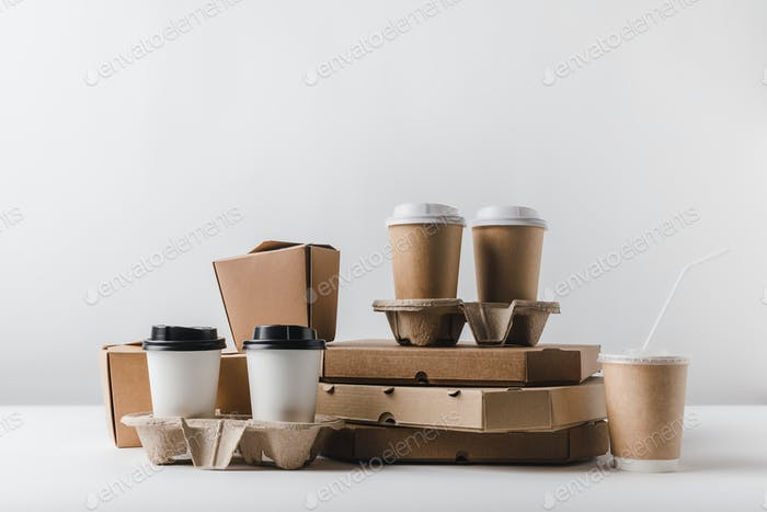 pizza boxes and coffee to go with take away boxes on tabletop