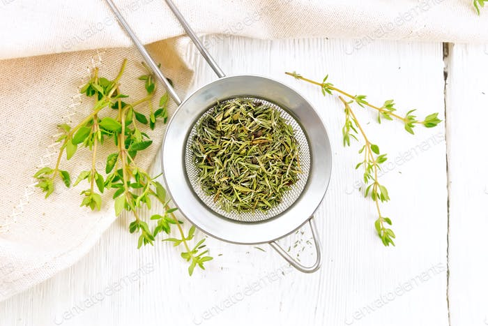 Thyme dry in strainer on board top