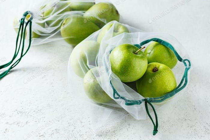 Fresh apples in reusable bags