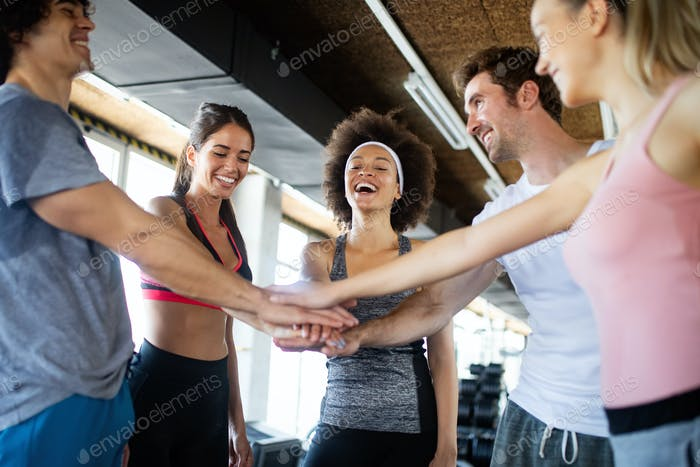Picture of cheerful fitness team in gym