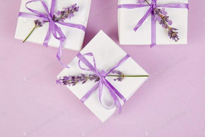 White Gift box with violet ribbon and lavender
