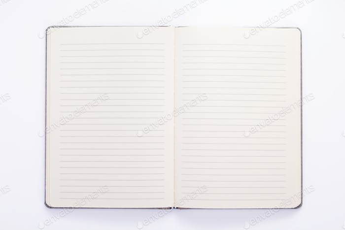 notepad or notebook paper at white background