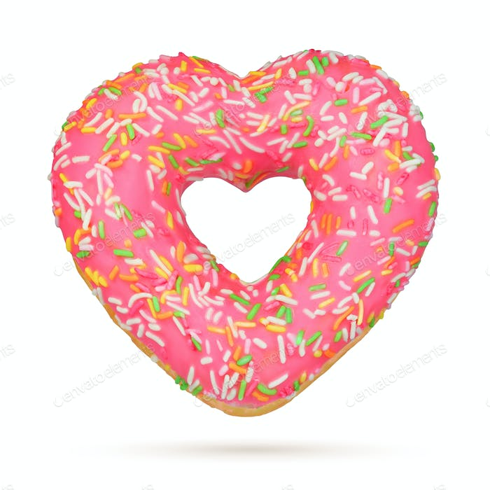 Valentine's Day Heart shape pink donut isolated on white