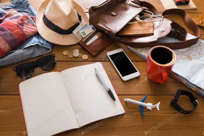 Set of travel things on wooden background