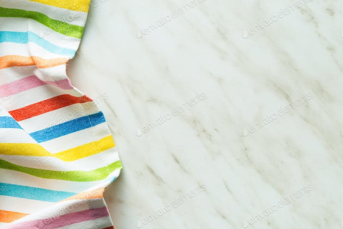 Top view of tablecloth or napkin on kitchen table.