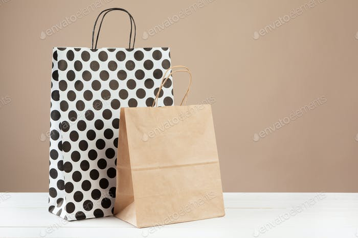 Arrangement of shopping bags on beige background