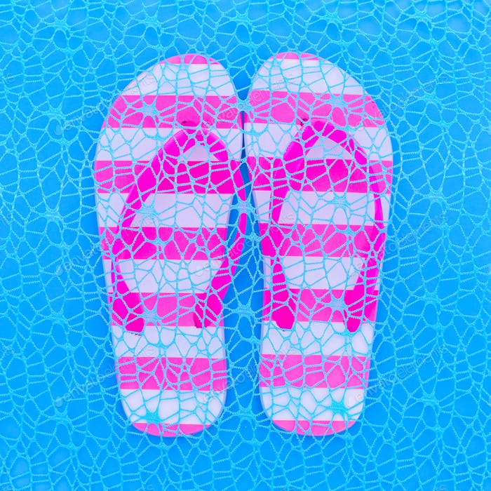 Flip flop and blue background. Ocean vibration. Minimal art