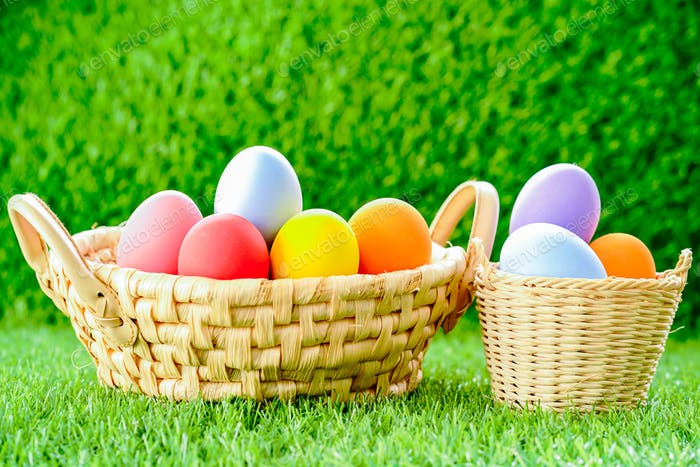 Easter eggs in the basket on green grass-8