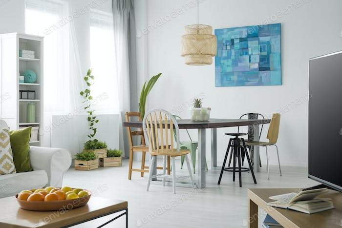 White apartment with green plants