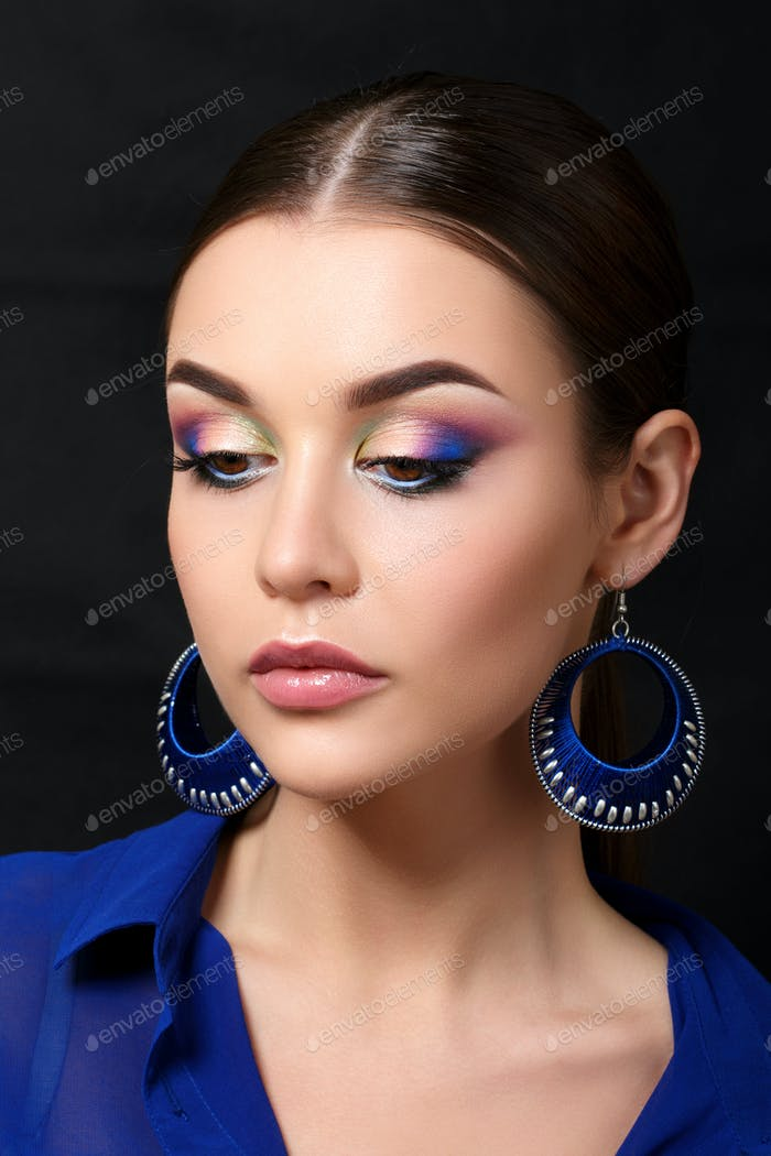 Portrait of beautiful woman with fashion makeup