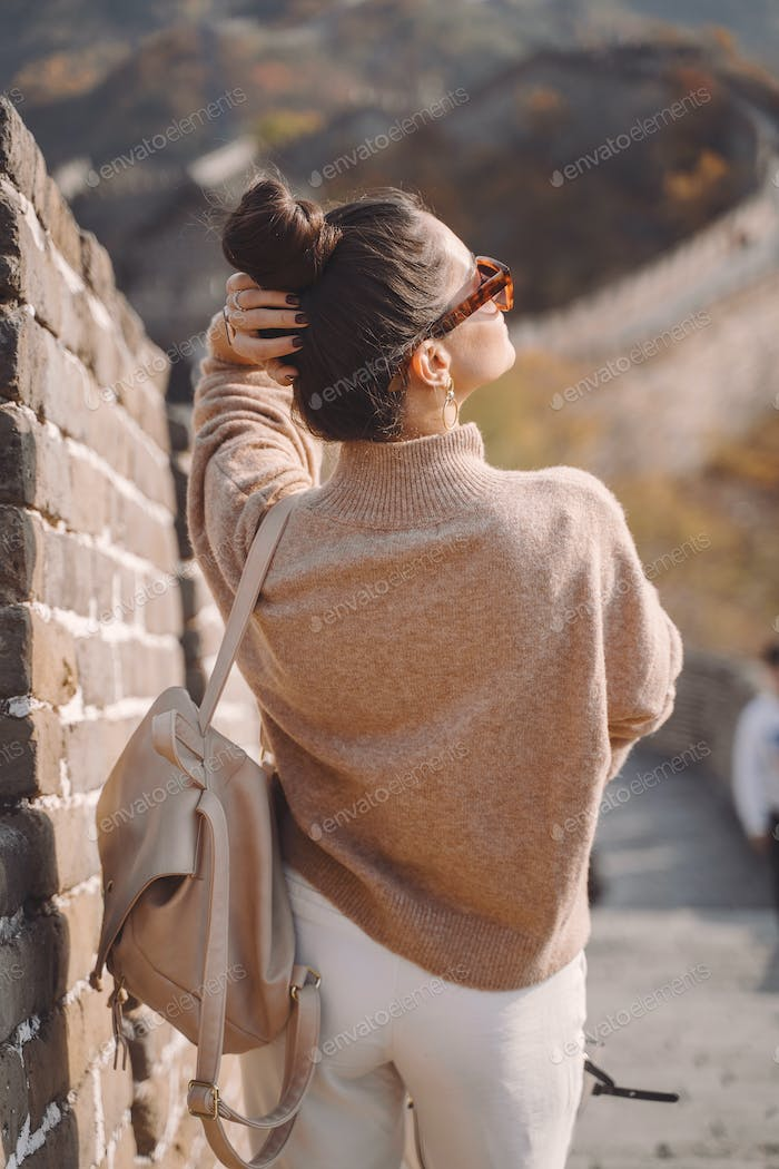 stylish girl visiting the Great Wall of China