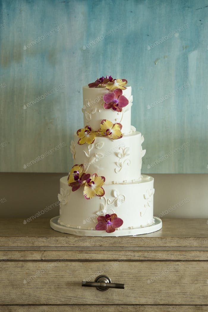 Three tier wedding cake with orchids