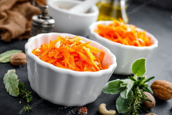 Fresh carrot salad with oil and nuts