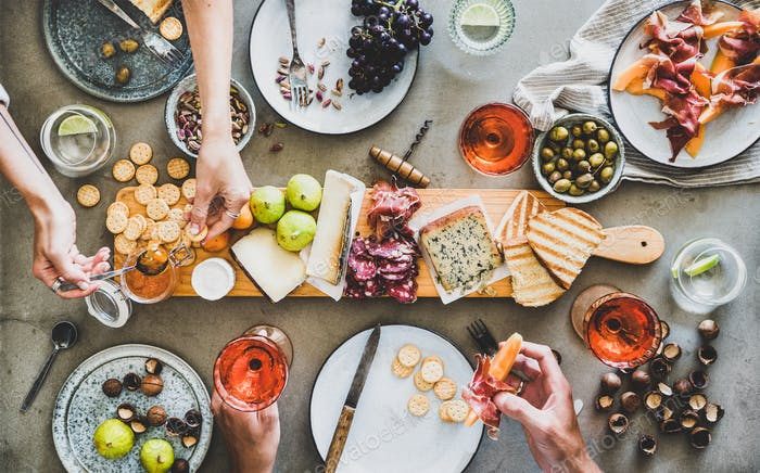Mid-summer picnic with rose wine, cheese, charcuterie and appetizers