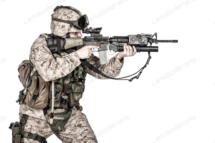 Screaming machine gunner soldier shooting from waist