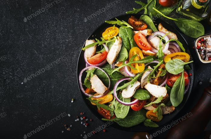 salad with spinach, grilled chicken, cherry tomatoes, arugula