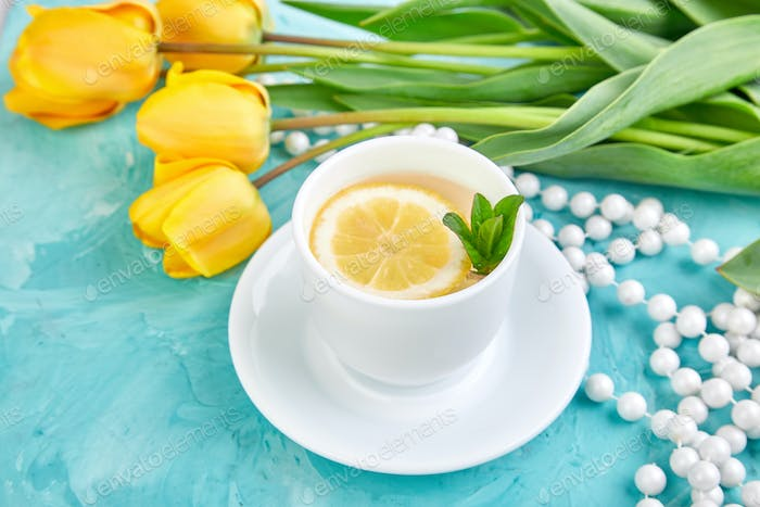 White cup of tea with lemon