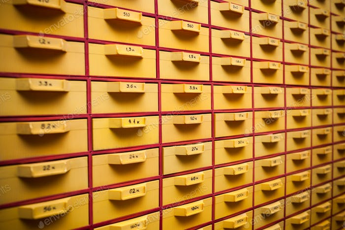 Security guard a large yellow cabinet with cells
