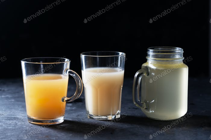 Three types of Homemade Beef Bone Broth in Glasses on a black background